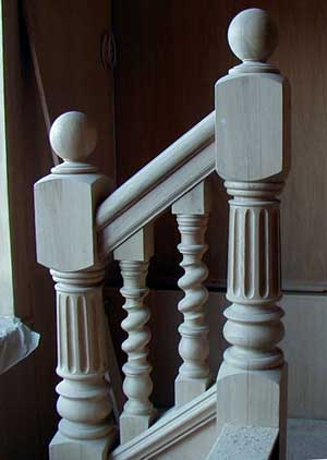Fluted Oak newels with single twist balusters.